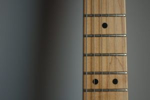 6 reasons guitar frets buzz